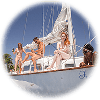 Nudist sailing on the river