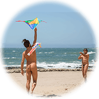flying a kite at nude beach