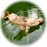 nude couple in pond